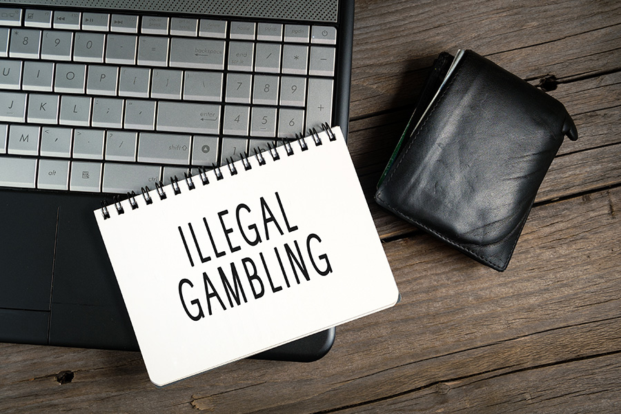 A police officer is among those suspected of running an illegal gambling den.