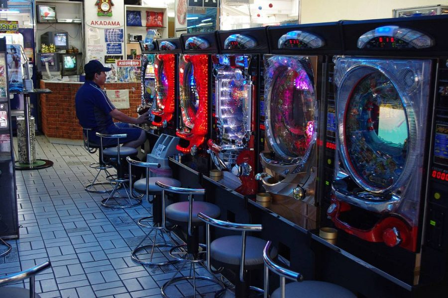 Three people were arrested during the raid at a pachinko parlour.