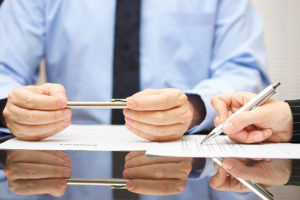 A new purchase agreement will allow the merger to be approved despite low shareholder attendance.