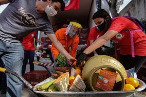 Peninsula Pacific Entertainment volunteers handed out meals.
